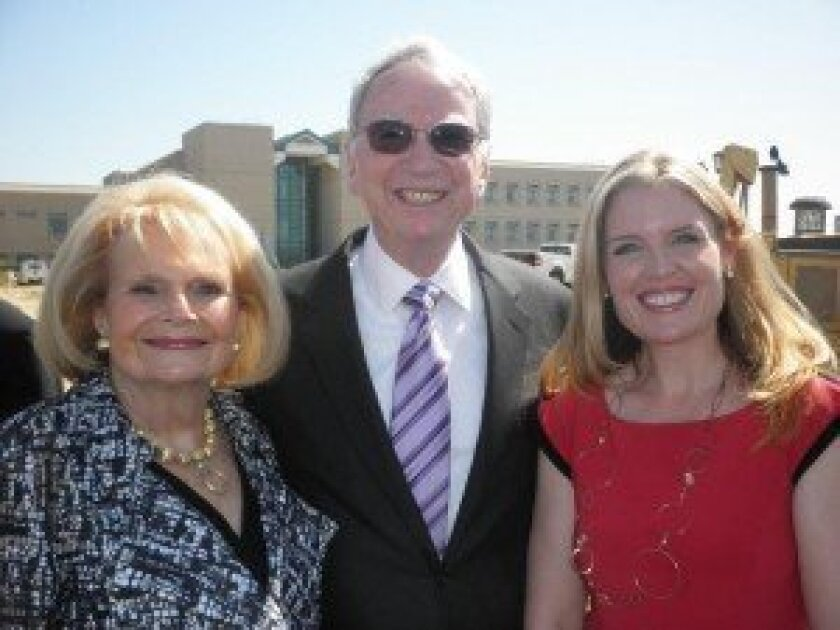 Lauren Reynolds (right), of At Home Care Solution, with Joan and Irwin Jacobs.