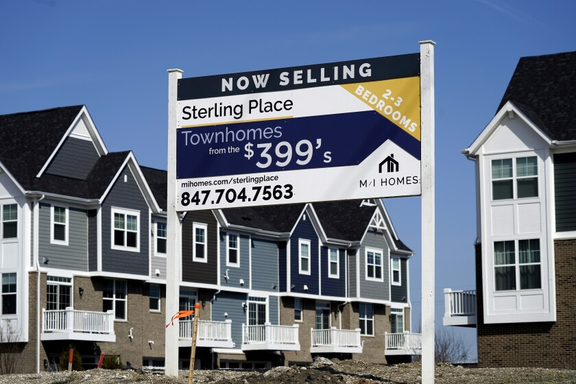 A sign advertises town houses for sale.