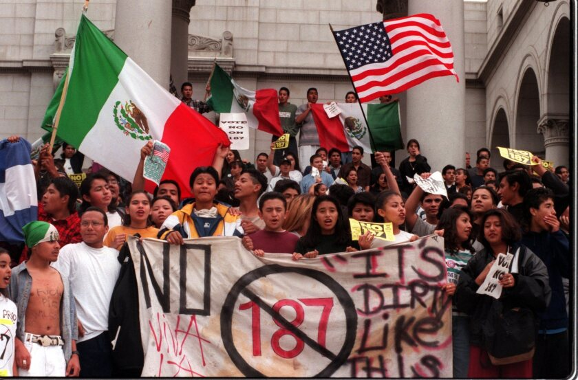 Students from Belmont High wave flags and yell from the steps of City Hall after walking out of school to protest Proposition 187 in November 1994.