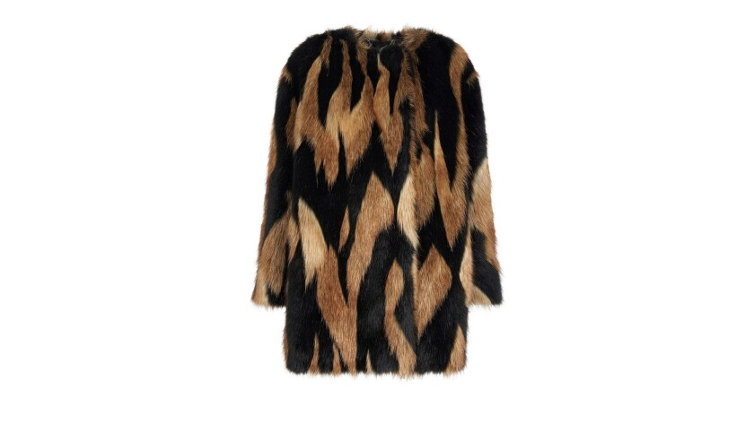 Aretha Franklin's love of fur coats is legendary. Givenchy bi-color black and hazelnut short faux fu