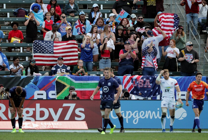 American fans cheer after the U.S. Eagles' Steve Tomasin, right, scores against Scotland on Feb. 29, 2020, at the HSBC World Rugby Sevens tournament.