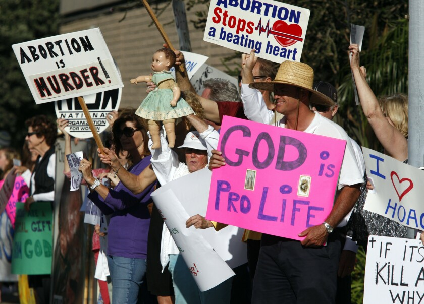 Antiabortion demonstrators gather in June outside Hoag Hospital in Newport Beach to celebrate its decision to halt elective abortions at the hospital. Hoag Hospital's decision was announced after it partnered with a Catholic healthcare provider, though administrators said the policy change on abortion was a business move by a hospital that performs fewer than 100 abortions a year.