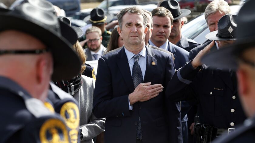 "Gov. Ralph Northam, shown here at the funeral of Virginia State Trooper Lucas B. Dowell on Saturday in Chilhowie, Va., said Sunday on CBS' ""Face the Nation"" that ""Virginia needs someone that can heal. There's no better person to do that than a doctor."""