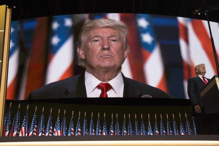 Donald Trump looks out across the crowd of delegates during the final night of the Republican National Convention in Cleveland last summer.