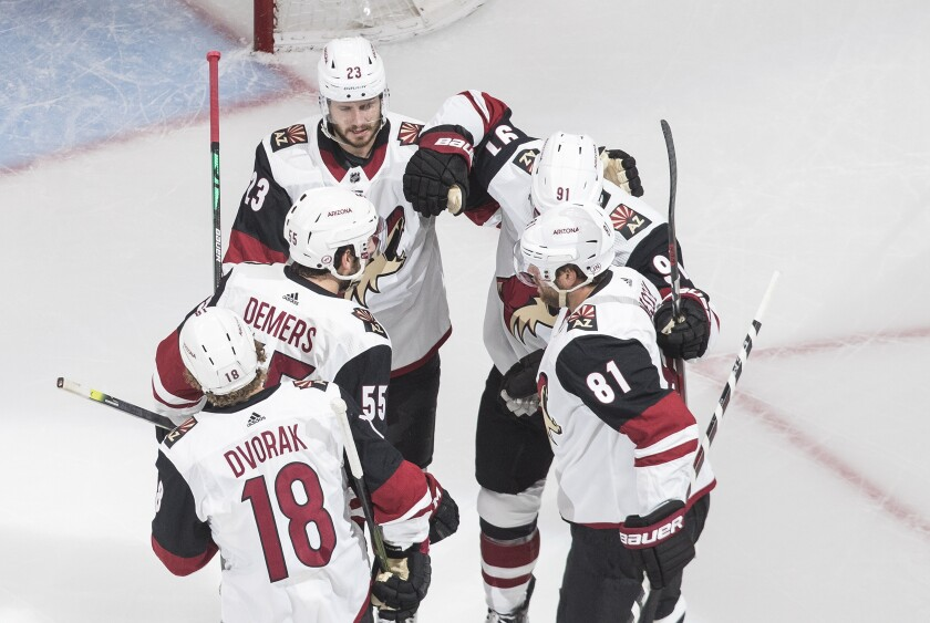 Arizona Coyotes celebrate a goal against there Nashville Predators during the first period NHL qualifying round game action in Edmonton, on Sunday, August 2, 2020. (Jason Franson/The Canadian Press via AP)