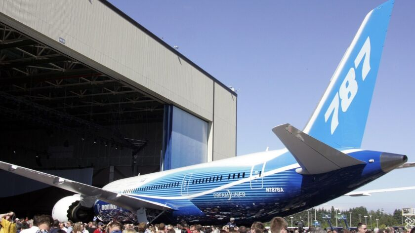 (FILES) In this 08 July 2007 file photo, the new Boeing 787 Dreamliner is unveiled during the world