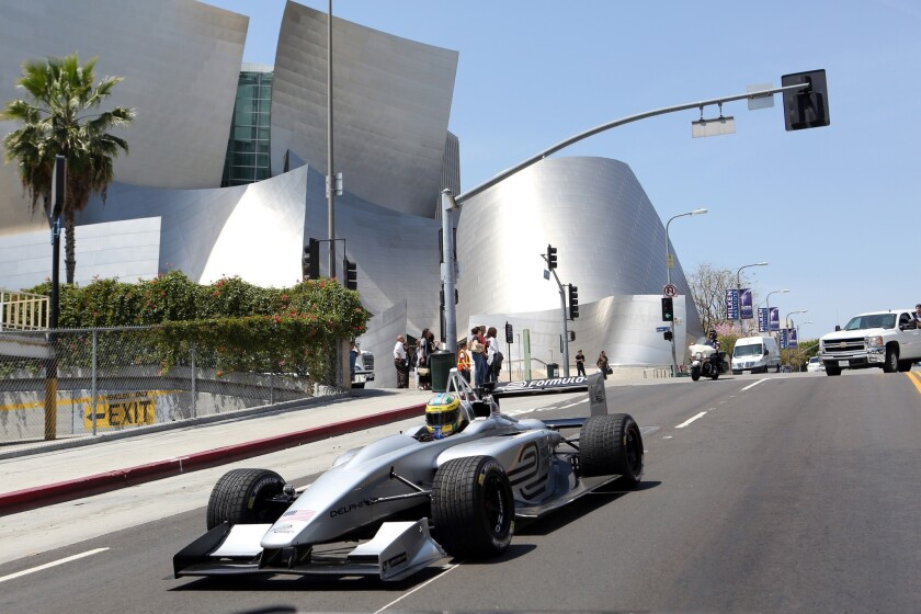 Lucas di Grassi drives a fully-electric Formula E race car past Disney Hall to promote the 2014 race season.