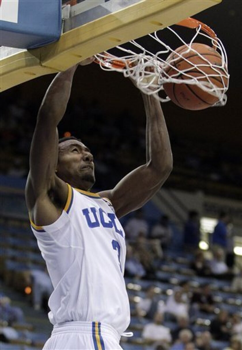 UCLA's Malcolm Lee dunks during the second half of their NCAA college exhibition basketball game with Westmont in Los Angeles, Thursday, Nov. 4, 2010. UCLA won 95-59. (AP Photo/Jae C. Hong)