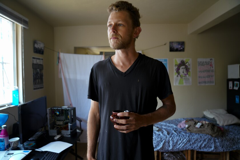 Josh Nichols, 34 enjoys a cup of coffee at his home in Tijuana that he shares with roommates along with his fiancée, Alejandra Lopez Uribe. Following a travel trip to Mexico, Nichols found a strong connection with the people he met along the way in Mexico which had a big influence on his decision to relocate to Mexico.