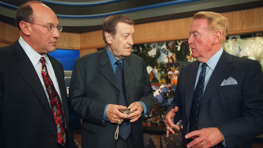 Three legends of Los Angeles sports broadcasting gather for a taping of the Carl's Jr. Sports Roundt