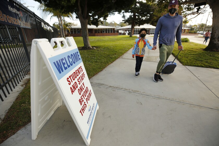 A student returns this week to reopened campus in Redondo Beach.