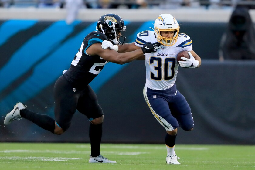 Chargers running back Austin Ekeler tries to push past Jacksonville Jaguars safety Marcus Gilchrist.