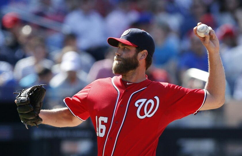 Washington Nationals relief pitcher Matt Thornton (46) delivers in a baseball game against the New York Mets in New York, Sunday, May 3, 2015. (AP Photo/Kathy Willens)