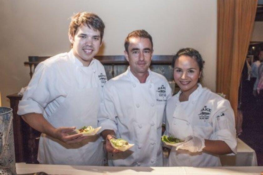 Hake Kitchen & Bar's Sous-Chef Stephen Tien, Partner/Chef Ricardo Dondisch and Kitchen Manager Sherry Zulueca serve rib-eye lettuce wraps.