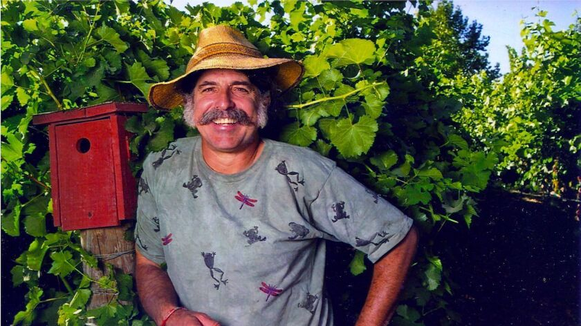 Amigo Bob Cantisano poses amidst plants