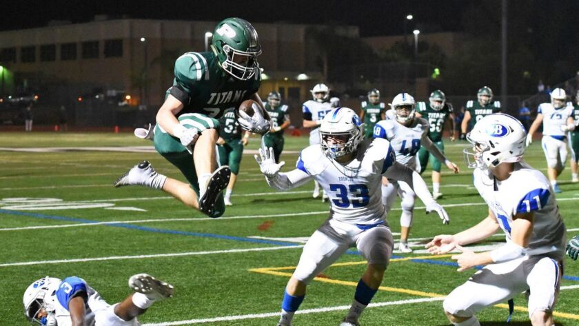 Poway High running back Josh Butler takes to the air to score a touchdown during Friday night's win