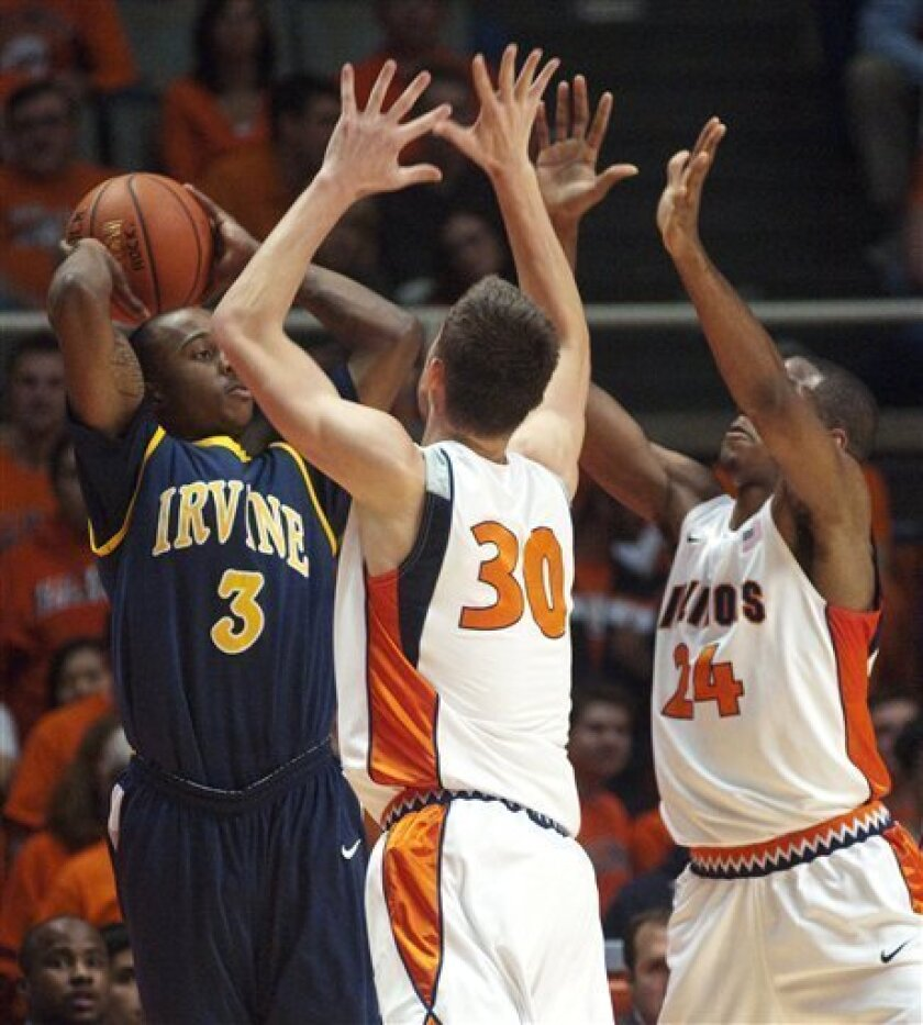 Illinois' Bill Cole (30) and Mike Davis (24) work to trap UC Irvine's Derrick Strings (3) during the first half of an NCAA college basketball game Monday, Nov. 8, 2010, in Champaign, Ill. (AP Photo/Robert K. O'Daniell)