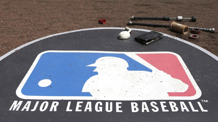 Major League Baseball hopes to resume play this summer, but owners and players are still negotiating how that would happen.