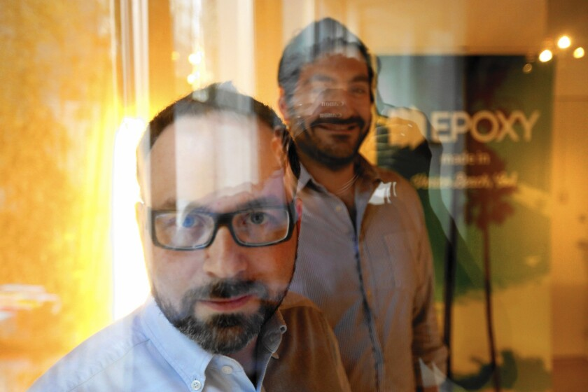 Juan Bruce, left, and Jason Ahmad started building Epoxy while at Team Downey — founded by actor Robert Downey Jr. and his wife, Susan — and spun it out when they realized that there was demand for the software.