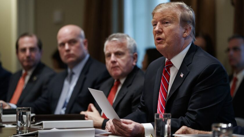 President Trump speaks during a cabinet meeting in Washington on Feb. 12.