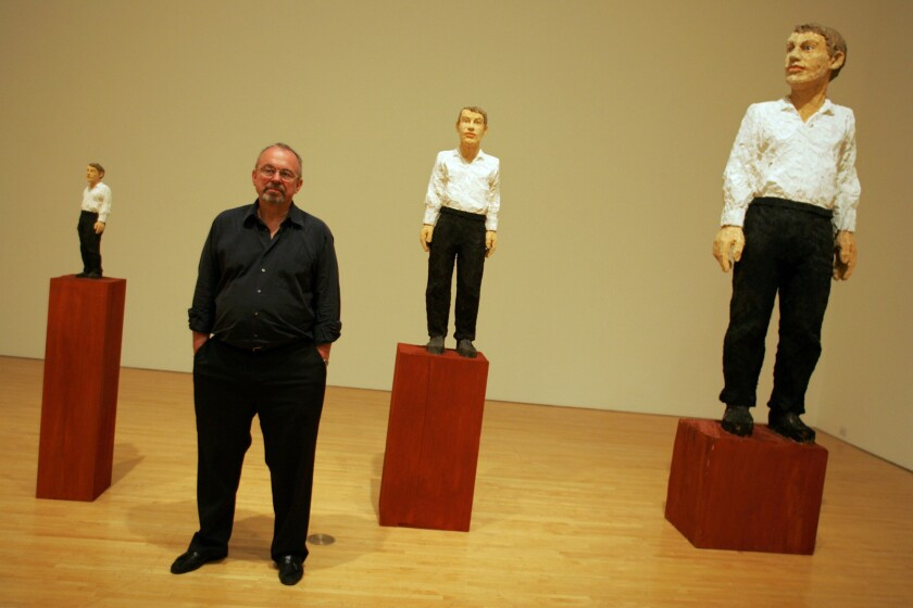 "In this 2005 archival photo, Blake Byrne, a retired TV executive, stands next to a sculpture by artist Stephan Balkenhol titled ""Vier Figurengruppe,"" on display at the Museum of Contemporary Art. The sculpture is one of many pieces of art that Byrne has donated to MOCA."