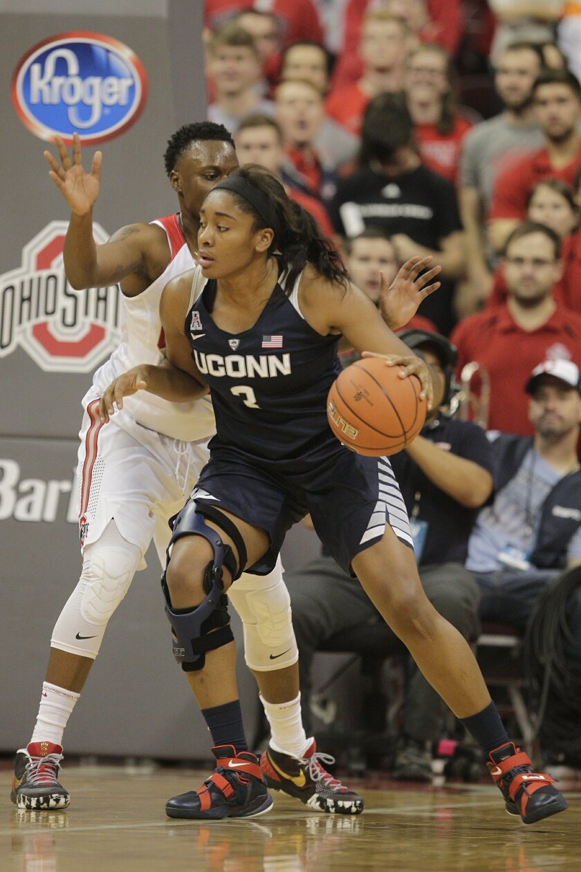 FILE - In this Nov. 16, 2015, file photo, Connecticut's Morgan Tuck posts up against Ohio State's Shayla Cooper during an NCAA college basketball game in Columbus, Ohio. Morgan Tuck believes her surgically repaired right knee only has a few more good years of basketball left in it.  That has the re