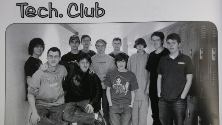 This undated photo shows Adam Lanza, third from the right, posing for a group photo of the technolog