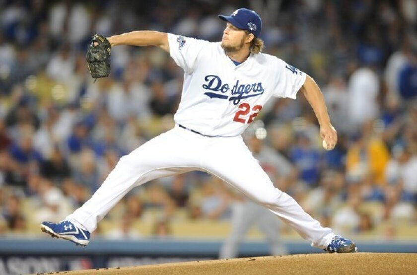 Dodgers starter Clayton Kershaw delivers a pitch during the first inning of the Dodgers' 4-3 victory over the Atlanta Braves in Game 4 of the National League division series Monday.