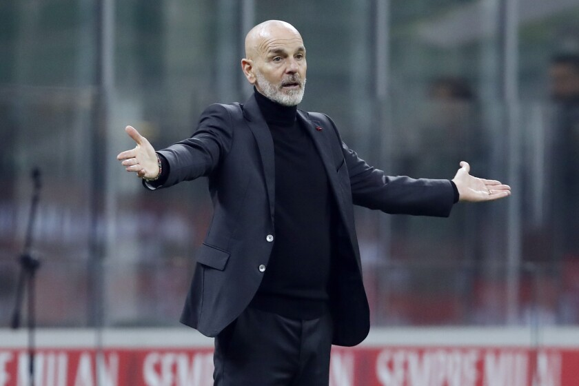 AC Milan coach Stefano Pioli reacts on the sideline during the Serie A soccer match between AC Milan and Udinese at the San Siro stadium, in Milan, Italy, Wednesday, March 3, 2021. (AP Photo/Antonio Calanni)