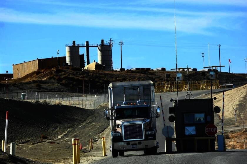 A truck exits the Chemical Waste Management site near Kettleman City, Calif. The facility, which has a history of violations, has agreed to pay $311,000 for not reporting 72 spills of hazardous materials in the last four years.