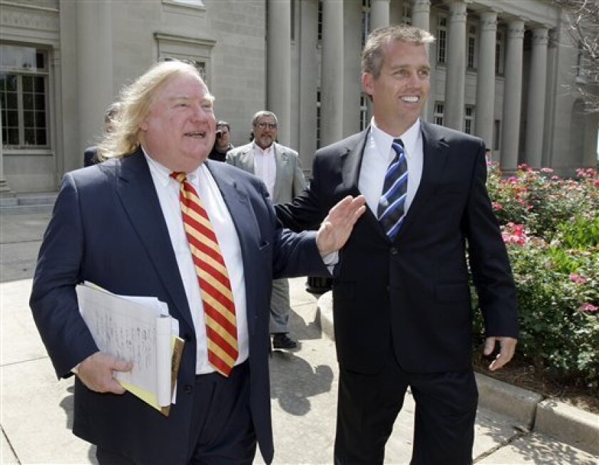 NASCAR driver Jeremy Mayfield, right, smiles as he leaves the federal courthouse with his attorney, Bill Diehl, left, in Charlotte, N.C., Wednesday, July 1, 2009. A judge lifted Mayfield's suspension, saying the NASCAR driver should be allowed to race. (AP Photo/Chuck Burton)