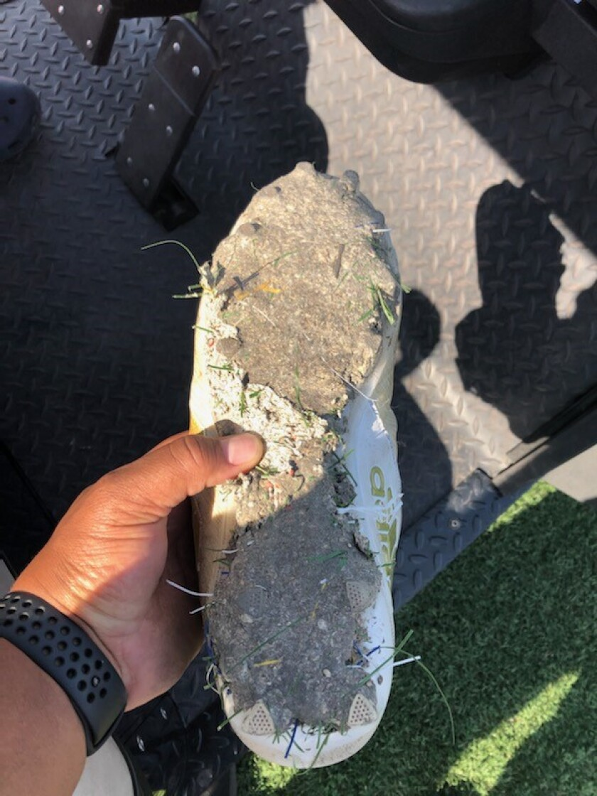 A cleat is covered with the strange substance from Crenshaw High's all-weather turf field.