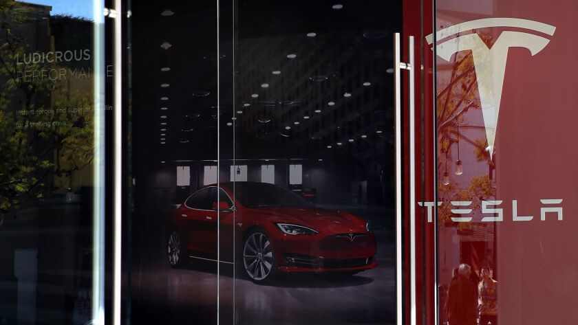 SANTA MONICA, CA - FEBRUARY 23: A sign is posted at a Tesla showroom on February 23, 2017 in Santa