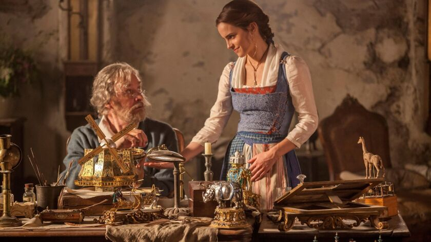 "Maurice (Kevin Kline) and daughter Belle (Emma Watson) in their poor, provincial town in Disney's ""Beauty and the Beast."""