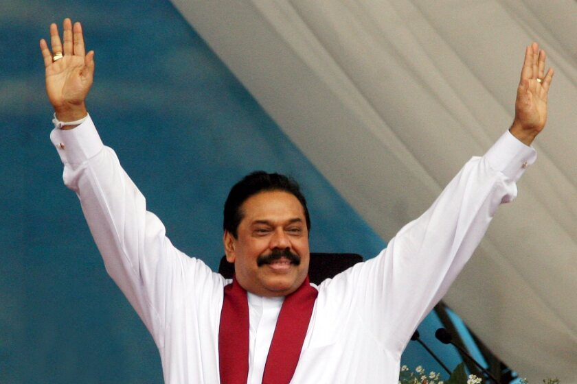 Then-President Mahinda Rajapaksa of Sri Lanka greets the crowd during a rally in Colombo, the capital, on May 22, 2009.
