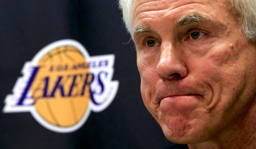 Lakers General Manager Mitch Kupchak listens to a question from a reporter during a news conference in El Segundo on Friday.