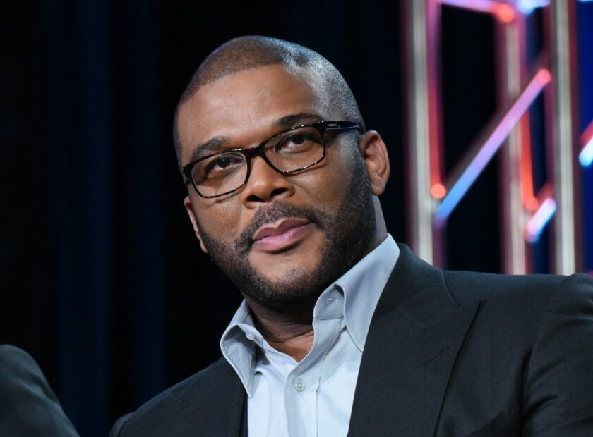 """FILE - In this Jan. 15, 2016 file photo, Tyler Perry participates in a panel for """"The Passion"""" at the Fox Winter TCA in Pasadena, Calif. Perry is producing a drama about a woman involved in a political sex scandal, the first scripted series that will air on the TLC network. TLC said Wednesday, March 30, that the eight-episode series, tentatively titled """"Too Close to Home,"""" will air this summer. (Photo by Richard Shotwell/Invision/AP, File)"""