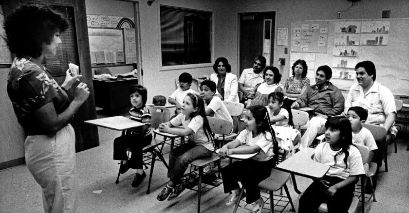 Yolanda Gonzalez teaches Resolana, a Saturday morning school where children are taught Spanish and la cultura, in 1983.