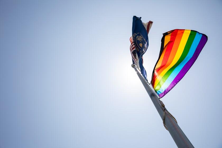 A Pride flag flies above La Mesa City Hall following a hoisting ceremony on June 22, 2020 in La Mesa, California.