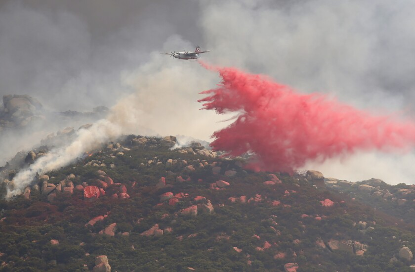 A CDF aircraft drops fire retardant on the Valley Fire.