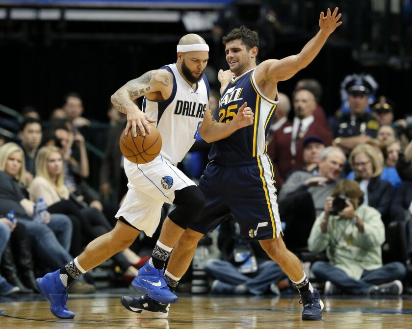 Dallas Mavericks' Deron Williams, drives past Utah Jazz's Raul Neto (25) of Brazil for a shot opportunity in the second half of an NBA basketball game, Tuesday, Feb. 9, 2016, in Dallas. The Jazz won in overtime 121-119. (AP Photo/Tony Gutierrez)