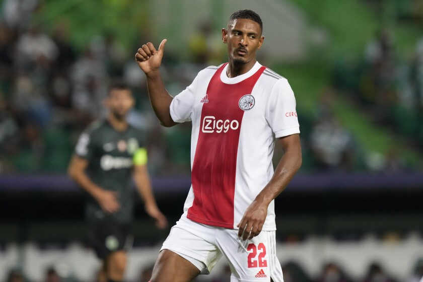 Ajax's Sebastien Haller gestures during a Champions League, Group C soccer match between Sporting CP and Ajax at the Alvalade stadium in Lisbon, Wednesday, Sept. 15, 2021. (AP Photo/Armando Franca)