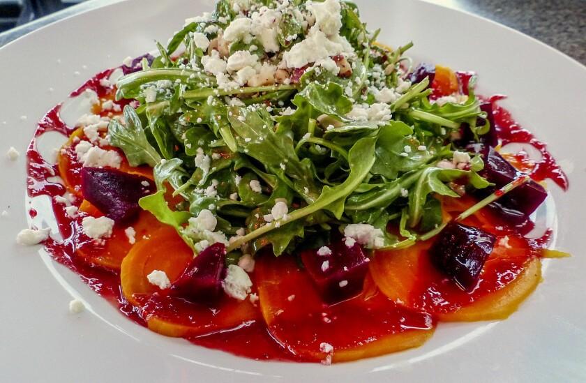 A crisp golden beet carpaccio salad kicks off a fine meal on the harborside deck at Steamship Grill and Bar.