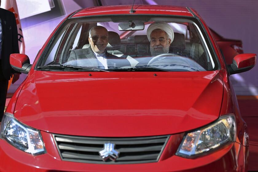 Iranian President Hassan Rouhani and minister Mohammad Reza Nematzadeh