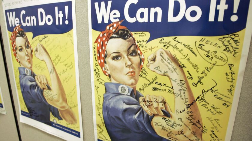 **ADVANCE FOR SUNDAY, DEC. 30, 2007** A poster showing signatures of former Rosie the Riveter's is s