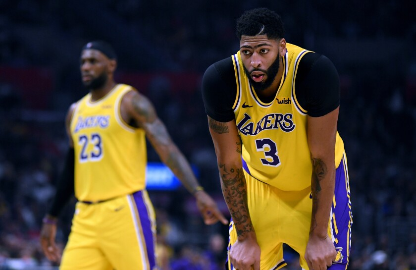 Lakers star Anthony Davis stands on the court during a game against the Clippers.