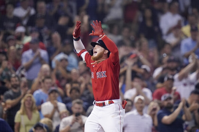 Boston Red Sox's Alex Verdugo celebrates as he heads home after his two-run home run in the eighth inning of a baseball game against the Toronto Blue Jays at Fenway Park, Monday, July 26, 2021, in Boston. (AP Photo/Charles Krupa)