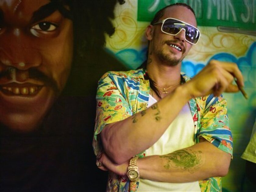 """This film image released by A24 Films shows James Franco in a scene from """"Spring Breakers."""" (AP Photo/A24 Films, Michael Muller)"""