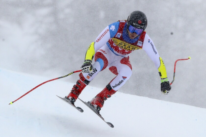 Switzerland's Mauro Caviezel speeds down the course during an alpine ski men's World Cup Super G in Val d' Isere, France, Saturday, Dec. 12, 2020. (AP Photo/Gabriele Facciotti)