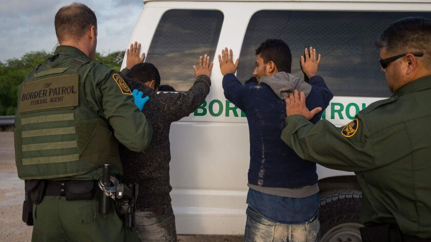 Border Patrol agents arrest migrants who crossed into the U.S. from Mexico near McAllen, Texas, in March.